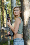 Young blonde with a rifle Royalty Free Stock Images