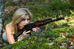 Young blonde with a rifle Stock Photo