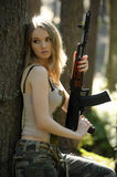 Young blonde with a rifle Royalty Free Stock Photo