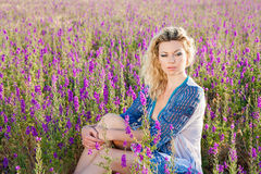 Young blonde in sage field Royalty Free Stock Photos