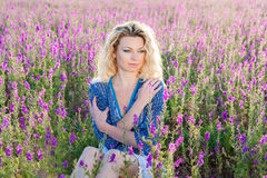 Young blonde in sage field Stock Photo