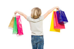 Young and blonde shopping girl from behind Stock Images