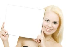 Young Blonde Smiling Woman With Blank Royalty Free Stock Photography