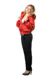 Young blonde standing in red jacket Stock Photos