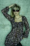 Young blonde with sunglasses is posing Royalty Free Stock Image