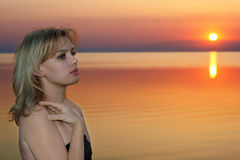 Young blonde at sunset royalty free stock photo