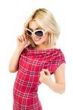Young blonde in tartan dress stock photo