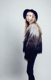 Young blonde teenage girl in hat and fur coat, Stock Images