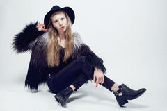 Young blonde teenage girl in hat and fur coat, Stock Image