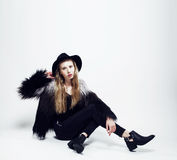 Young blonde teenage girl in hat and fur coat, fashion dressed m Royalty Free Stock Photos