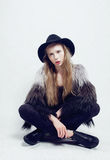 Young blonde teenage girl in hat and fur coat Stock Photos