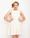 Young blonde in white dress posing Stock Photography