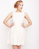 Young blonde in white dress posing Royalty Free Stock Photography