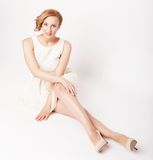Young blonde in white dress posing Royalty Free Stock Images