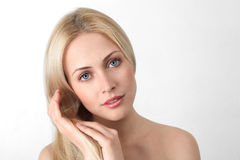 Young blonde woman Stock Images