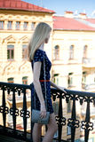 Young blonde woman against a city houses Stock Image