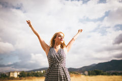Young blonde woman arms outstretched Stock Photos