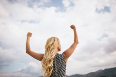 Young blonde woman arms outstretched Royalty Free Stock Photos