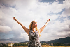 Young blonde woman arms outstretched Royalty Free Stock Photo