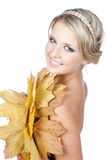 Young blonde woman with autumn leaves in hand Stock Image