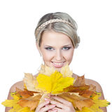 Young blonde woman with autumn leaves in hand Stock Photos