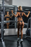 Young blonde woman barbell in gym Royalty Free Stock Photos