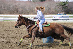 Young blonde woman barrel racing Royalty Free Stock Images