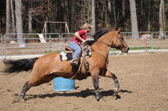 Young blonde woman barrel racing Stock Image