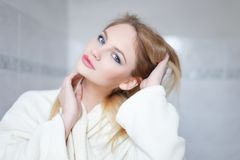Young blonde woman in bathrobe portrait Royalty Free Stock Images