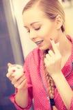 Woman applying moisturizing skin cream. Skincare. Royalty Free Stock Photos
