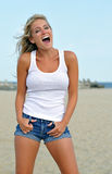 Young blonde woman at the beach Stock Photo