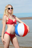 Young Blonde Woman at the Beach Stock Image