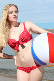 Young Blonde Woman with a Beach Ball Royalty Free Stock Images