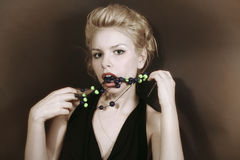 Young blonde woman with beads Stock Photos