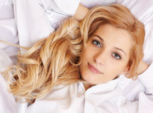 Young  blonde woman in the bed Stock Photos