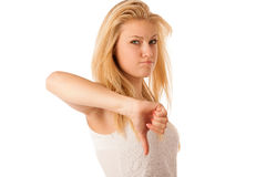 Young blonde woman with blue eyes gesturing failure and ange wit Stock Image