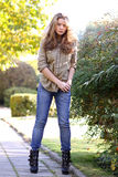 Young blonde woman in blue jeans Royalty Free Stock Photos