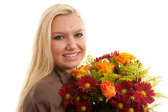 Young blonde woman with bouquet of flowers Stock Photos