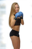 Young blonde woman with boxing gloves Royalty Free Stock Photo