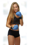 Young blonde woman with boxing gloves Royalty Free Stock Photography