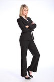 Young blonde woman in business suit arms folded Stock Photography