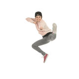 Young blonde woman in casual clothes jumping. Happy young blonde woman in casual clothes jumping and kicking isolated on white background Royalty Free Stock Images