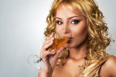 Young blonde woman with champagne Royalty Free Stock Photography