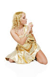Young blonde woman with champagne glass Royalty Free Stock Photography