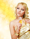 Young blonde woman with champagne glass Stock Image