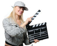 Young blonde woman with clapper board Royalty Free Stock Photos