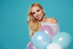 Young blonde woman with colored balloons Royalty Free Stock Photography