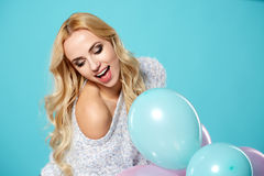 Young blonde woman with colored balloons Stock Photo