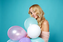 Young blonde woman with colored balloons Royalty Free Stock Images