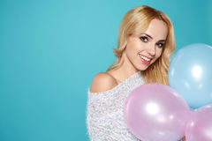 Young blonde woman with colored balloons Stock Image